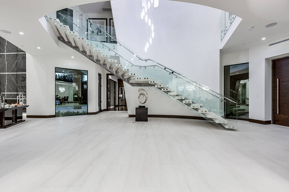The glass staircase. (Growth Luxury Homes)