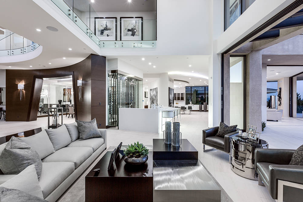 The dining room is off the living room and wine cooler. (Growth Luxury Homes)