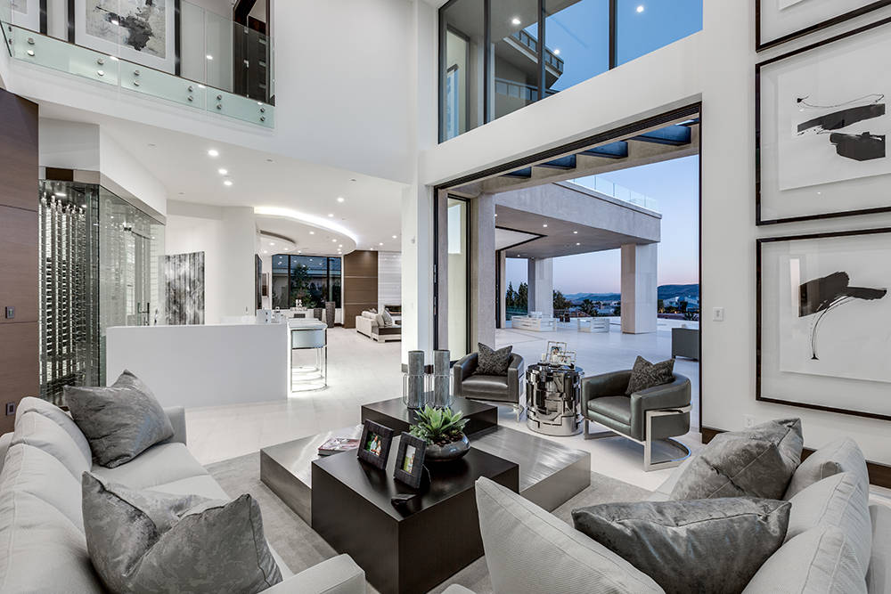The living room opens out to the patio. (Growth Luxury Homes)