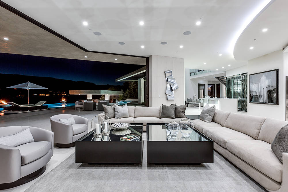 The wall opens to provide indoor-outdoor living. (Growth Luxury Homes)