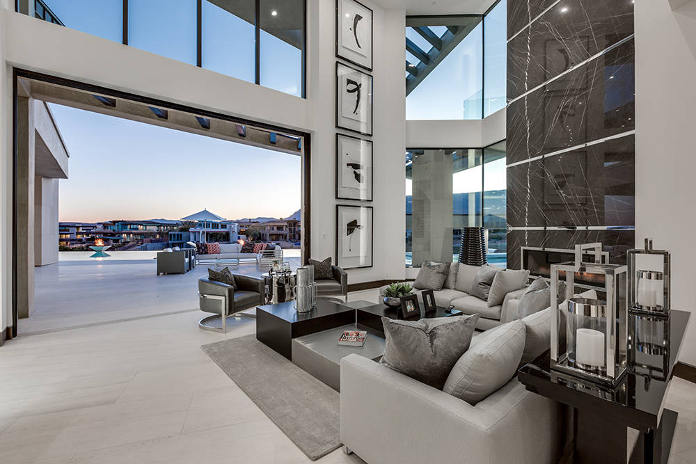 The home has a modern design with outdoor-indoor living features. (Growth Luxury Homes)