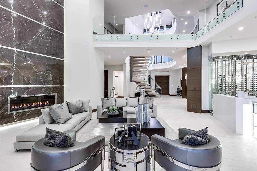The custom detailed design includes 12-foot ceilings on the main level, Lutron lighting, fully integrated sound system and seven gas fireplaces throughout the home. (Growth Luxury Homes)