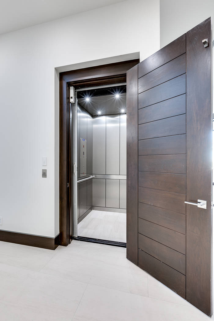 The elevator connects the three levels of the home. (Growth Luxury Homes)