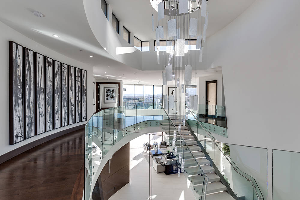 All the ornate lighting was designed by the GLH's in-house design team using materials of stainless steel, crystal and Murano Glass. (Growth Luxury Homes)