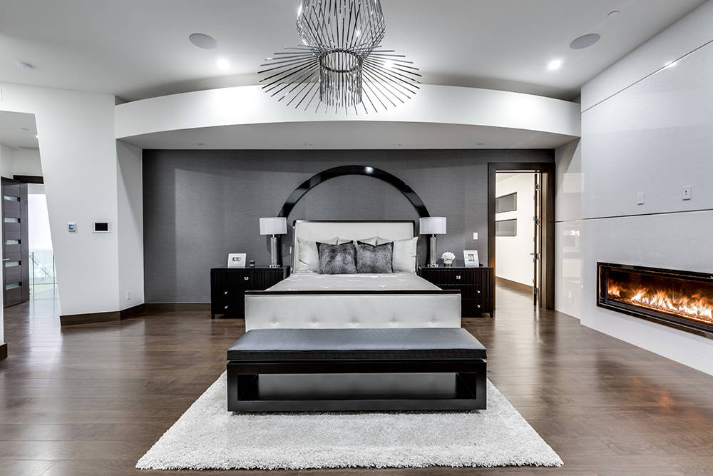 An approximately 1,913-square-foot master retreat features double walk-in closets with custom built-ins, and views of the Strip, golf course and mountains. (Growth Luxury Homes)