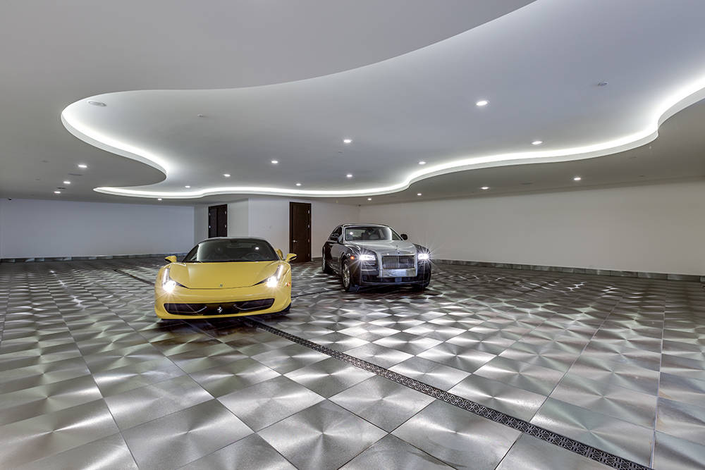 The 10-car subterranean garage features a porcelain floor that has the appearance of polished steel. (Growth Luxury Homes)