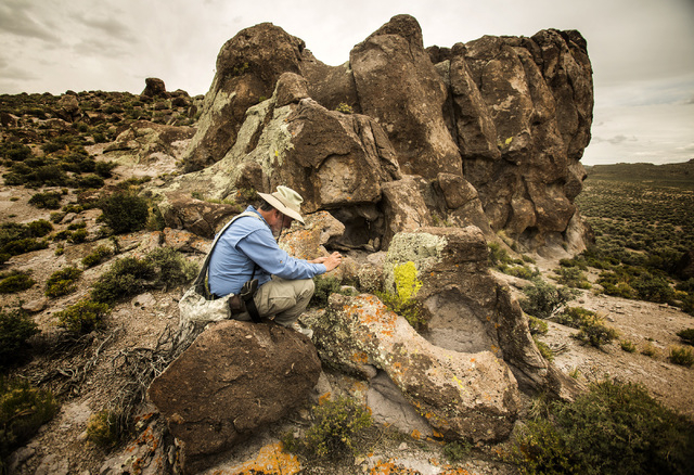 Naturalist and outdoorsman Jim Boone photographs a rock formation in Garden Valley in the Basin and Range National Monument, over a three hour drive north of Las Vegas, on Wednesday, May 20, 2015. ...