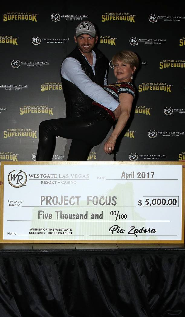 """Tony Davolani of """"Dancing With the Stars"""" dances with a star, Pia Zadora, at the Westgate Las Vegas on Tuesday, April 25, 2017, after delivering a $5,000 check for Zadora's chosen charity, Project ..."""