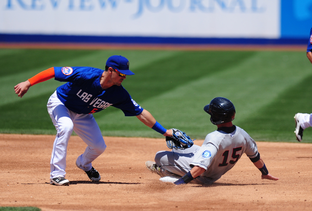 Tacoma base runner Boog Powell steals second base while Las Vegas second baseman Matt Reynolds fields the throw in the second inning of their Triple-A minor league baseball game at Cashman Field i ...