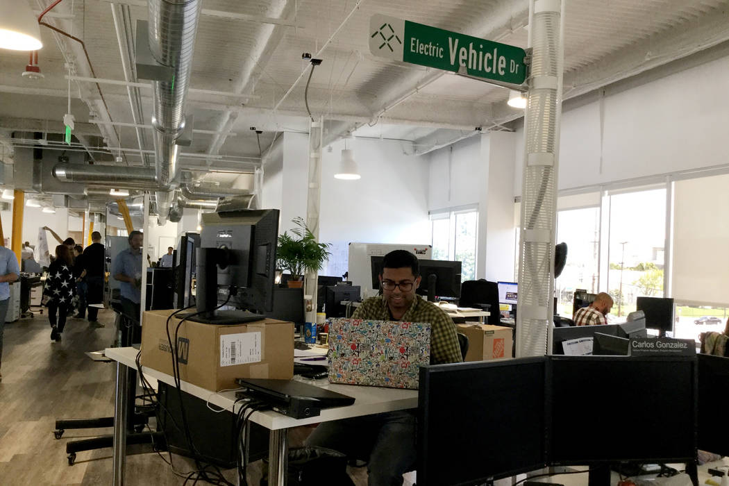 Navin Prabhu, a Faraday Future project engineer, is one of over 1,000 employees inside Faraday Future's main research and development building in Gardena, Calif. Prabhu sits in an open office spac ...