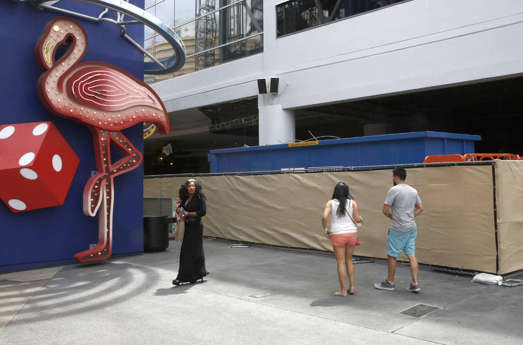 Tourists walk past the construction site of Fear the Walking Dead attraction on 425 Fremont St. on Thursday, April 27, 2017, in Las Vegas. Bizuayehu Tesfaye Las Vegas Review-Journal @bizutesfaye