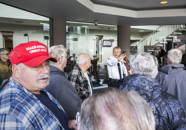 Security asks well owners to vacate the lobby of the Legislative Building during a protest against proposed measures to regulate domestic wells on Monday, Feb. 6, 2017, in Carson City. (Benjamin H ...
