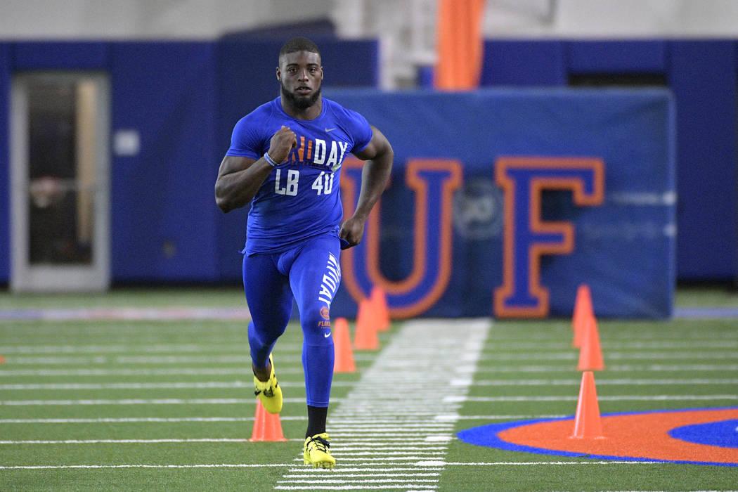 Linebacker Jarrad Davis (40) runs the 40-yard dash during Florida's NFL Pro Day in Gainesville, Fla., Tuesday, March 28, 2017. (AP Photo/Phelan M. Ebenhack)