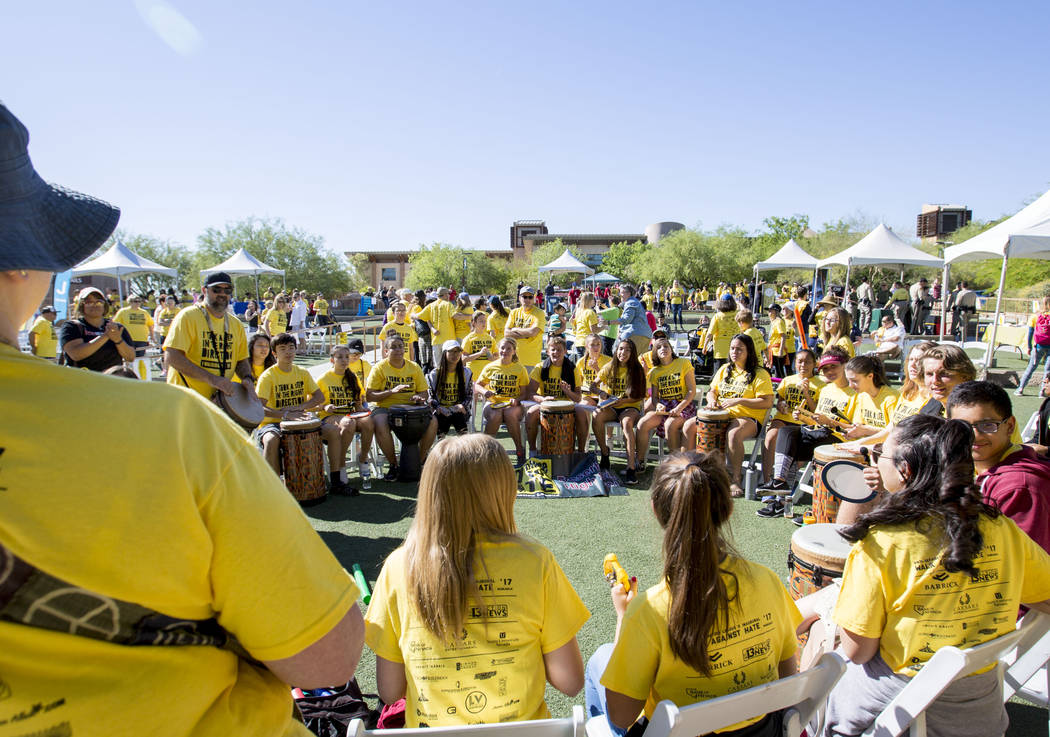 Attendees of the Walk Against Hate participate in a Community Productions drum circle at the Springs Preserve in Las Vegas, Sunday, April 30, 2017. The event is a fundraiser held by the Anti-Defam ...