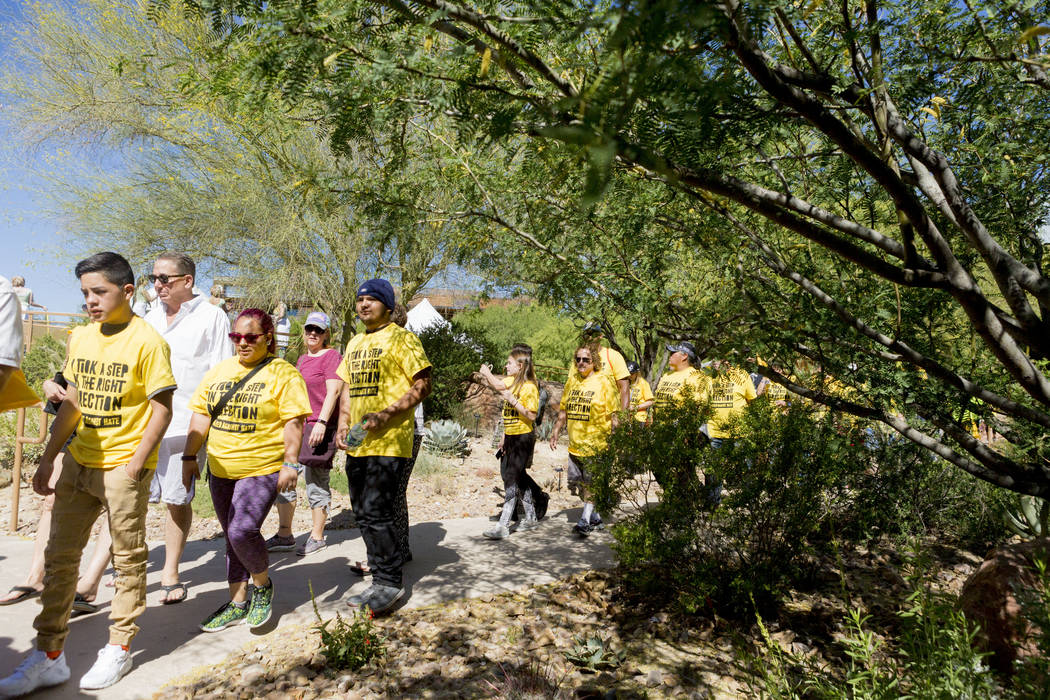 Participants begin the two mile walk during the Walk Against Hate at the Springs Preserve in Las Vegas, Sunday, April 30, 2017. The event is a fundraiser held by the Anti-Defamation League. Elizab ...