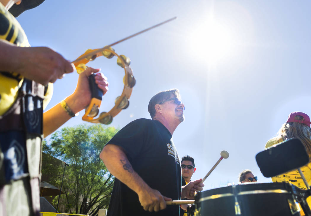 Community Productions drummer Michael Andrieu helps lead attendees of the Walk Against Hate in a drum circle at the Springs Preserve in Las Vegas, Sunday, April 30, 2017. The event is a fundraiser ...