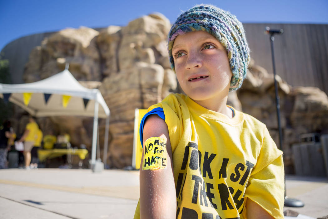 Participant in the Walk Against Hate Ryder Meyers, 8, is ready for the two mile walk and says he does not want the children to be bullied around, at the Springs Preserve in Las Vegas, Sunday, Apri ...