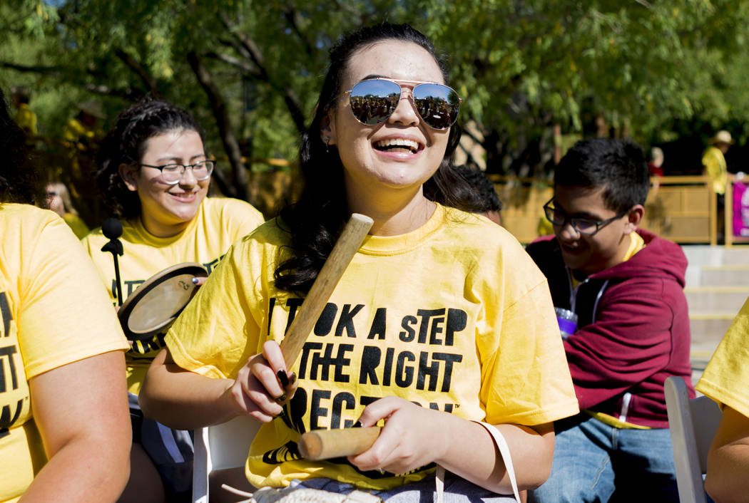 Desert Oasis High School student Alexandra Liaos, 15, participates in the Community Productions drum circle during the Walk Against Hate at the Springs Preserve in Las Vegas, Sunday, April 30, 201 ...