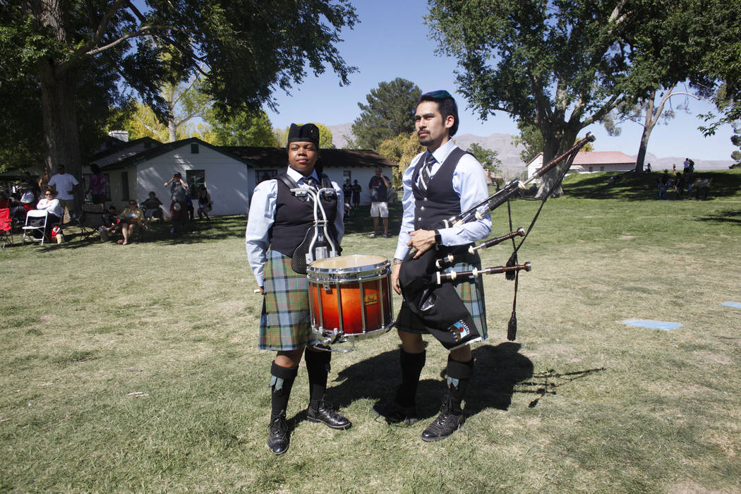 Leilani Lucas and Trevor Takahashi watch another bagpipe band compete at the Las Vegas Highland Games   on Sunday, April 30, 2017, at Floyd Lamb Park in Las Vegas. Rachel Aston Las Vegas Review-Jo ...