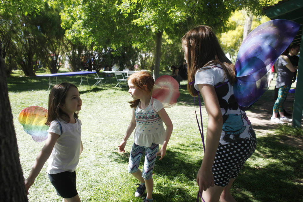 Violet Heart, 4, from left, Emilee Brouwers, 5, and Kaylee Brouwers, 10, play with butterfly wings on at the Las Vegas Highland Games on Sunday, April 30, 2017, at Floyd Lamb Park in Las Vegas. Ra ...