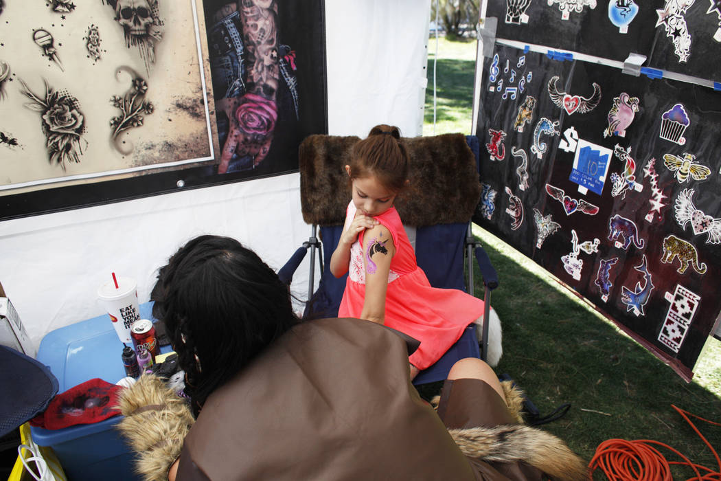 Hailee Ortega, 8, checks out her new temporary tattoo done by June Domenick, left, at the Las Vegas Highland Games on Sunday, April 30, 2017, at Floyd Lamb Park in Las Vegas. Rachel Aston Las Vega ...