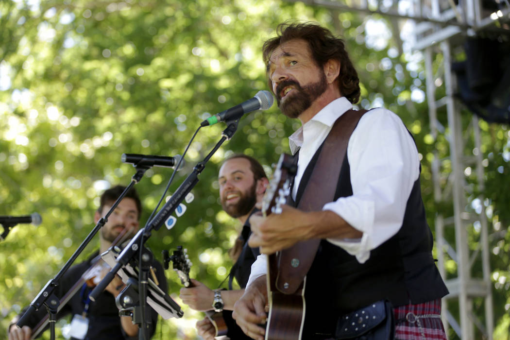Mark Romano, center, of the band Ploughboys, plays guitar and sings at the Las Vegas Highland Games on Sunday, April 30, 2017, at Floyd Lamb Park in Las Vegas. Rachel Aston Las Vegas Review-Journa ...