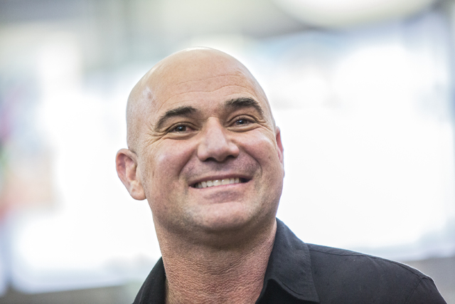 Andre Agassi listens to Nevada Gov. Brain Sandoval speak during a news conference Friday, Feb. 17, 2017, to announce that Democracy Prep Public Schools will assume school operations of Andre Agass ...