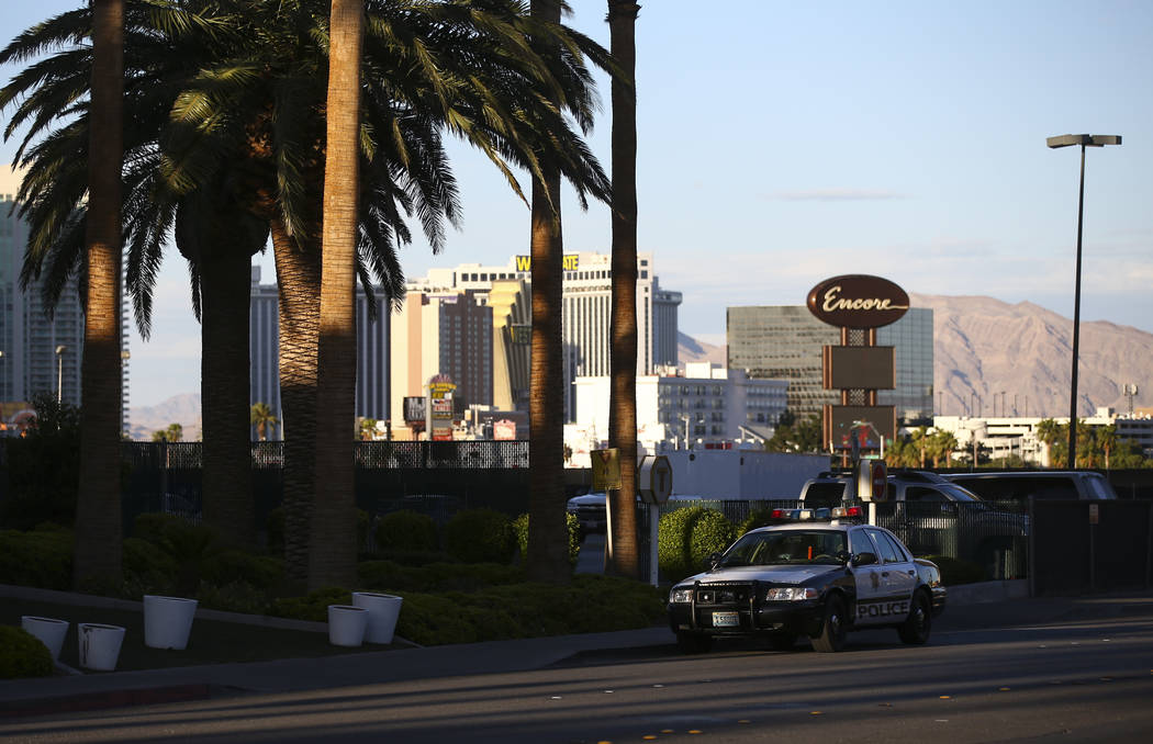 A Las Vegas police squad car sits outside of the Trump International after a suspect started a small fire in a bathroom at the hotel in Las Vegas on Wednesday, April 26, 2017. Chase Stevens Las Ve ...