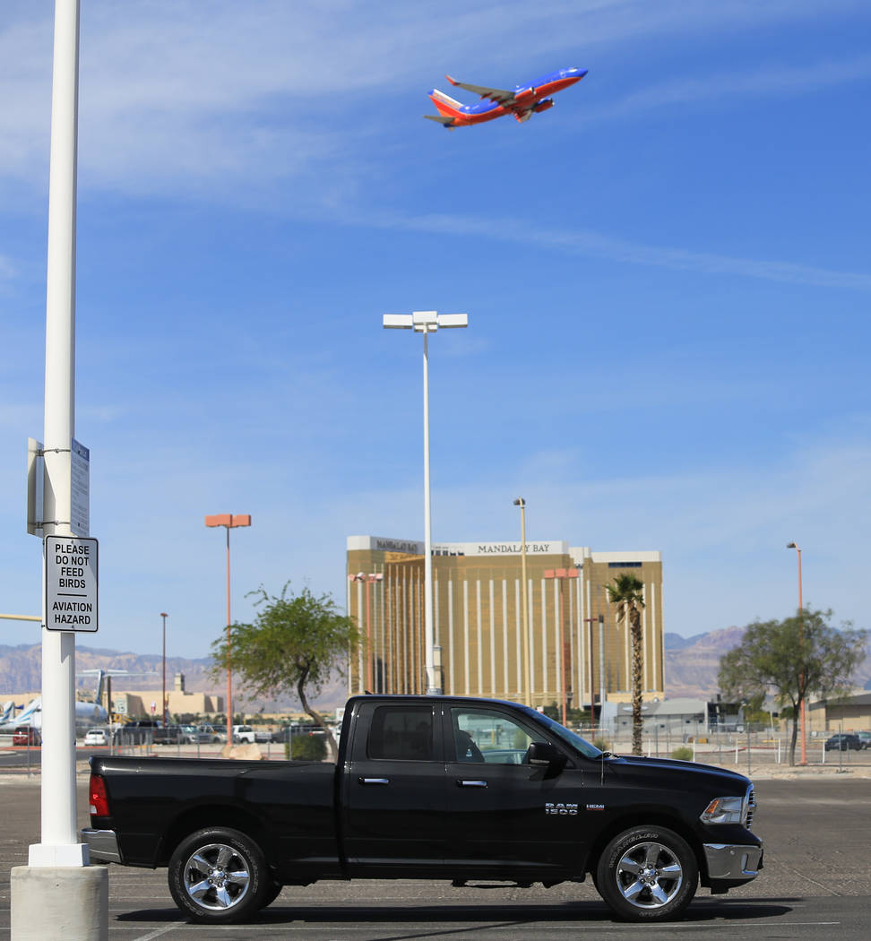 A Southwest flight lifts off above cars at a mostly empty cell phone lot of McCarran International Airport in Las Vegas on Thursday, April 27, 2017. Brett Le Blanc Las Vegas Review-Journal @blebla ...