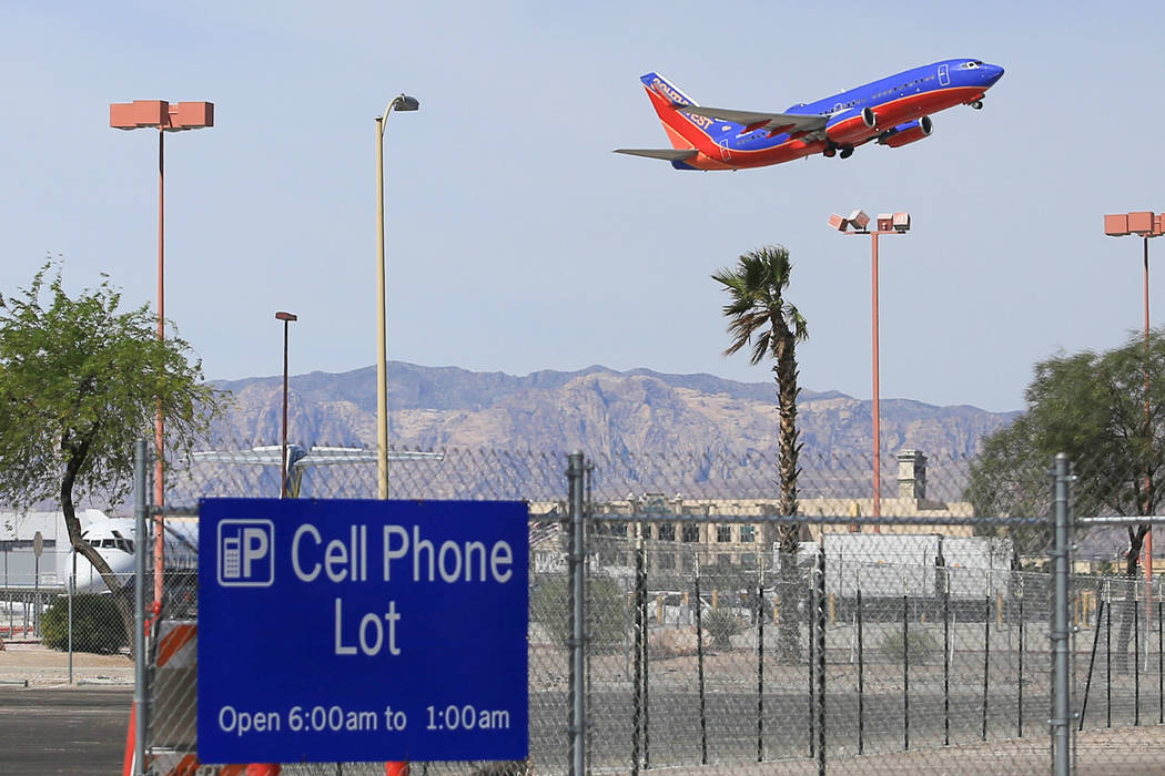 A Southwest flight lifts off above a mostly empty cell phone lot of McCarran International Airport in Las Vegas on Thursday, April 27, 2017. Brett Le Blanc Las Vegas Review-Journal @bleblancphoto