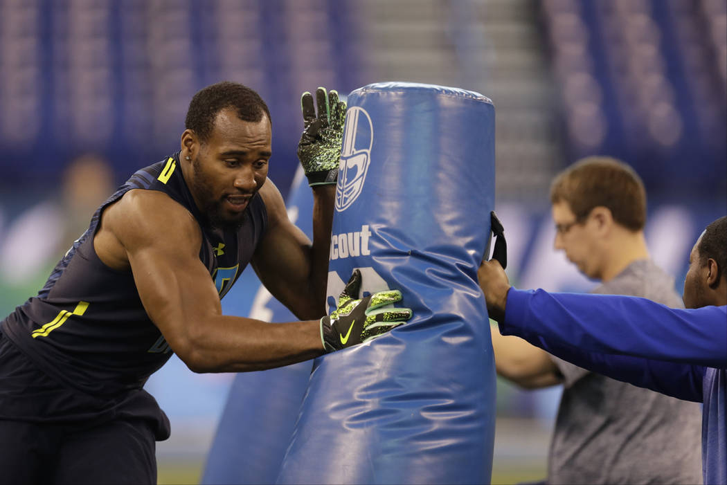 Temple defensive end Haason Reddick runs a drill at the NFL football scouting combine Sunday, March 5, 2017, in Indianapolis. (AP Photo/David J. Phillip)