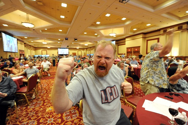A man, who didn't give his name, reacts after watching the finish of the Kentucky Derby during a during a viewing party inside the grand ballroom at the South Point Casino and Hotel in Las Vegas S ...