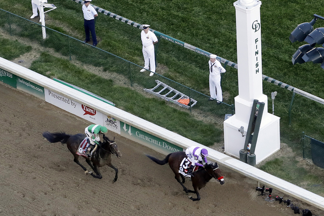 In this May 7, 2016, file photo, jockey Mario Gutierrez rides Nyquist to victory ahead of Exaggerator, ridden by Kent Desormeaux, in the 142nd running of the Kentucky Derby horse race at Churchill ...