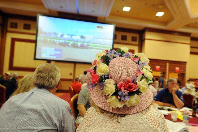 A women watches the Kentucky Derby during a viewing party inside the grand ballroom at the South Point Casino and Hotel in Las Vegas Saturday May 03, 2015.(Josh Holmberg/Las Vegas Review Journal)