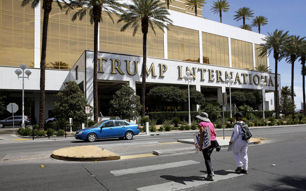 Anti-drone protesters cross the street to the Trump International Hotel on Thursday, April 27, 2017, in Las Vegas. Christian K. Lee Las Vegas Review-Journal @chrisklee_jpeg