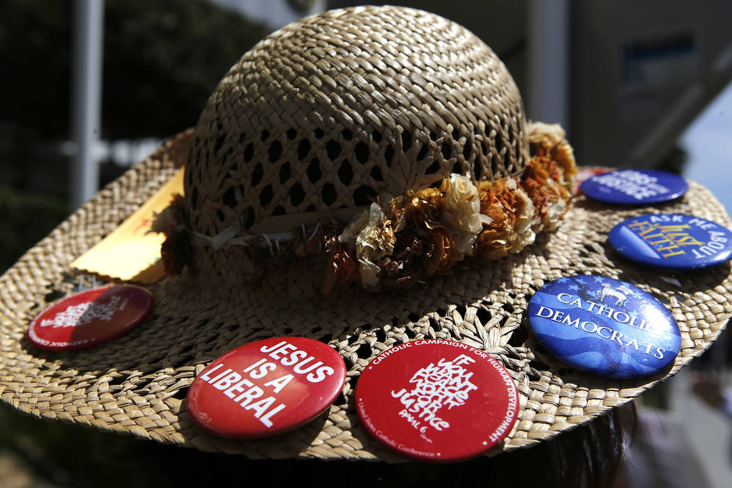 An anti-drone protester wears pins on her hat at the Trump International Hotel on Thursday, April 27, 2017, in Las Vegas. Christian K. Lee Las Vegas Review-Journal @chrisklee_jpeg