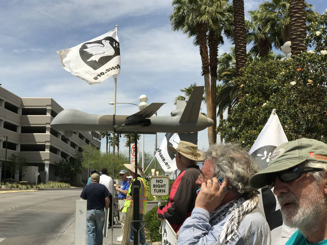 About 20 anti-drone warfare demonstrators converged Thursday, March 27, 2017, in front of the Trump International building in Las Vegas. Keith Rogers Las Vegas Review-Journal