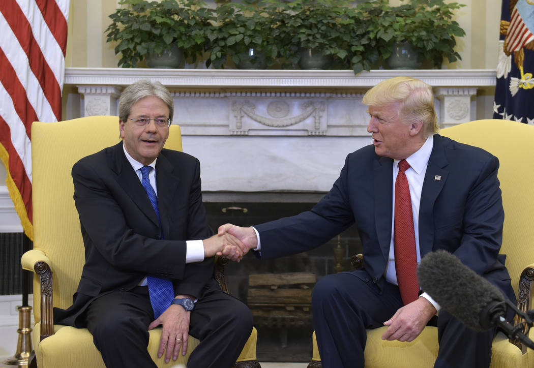 President Donald Trump, right, shakes hands as he meets with Italian Prime Minister Paolo Gentiloni, left, in the Oval Office of the White House in Washington, Thursday, April 20, 2017. (AP Photo/ ...