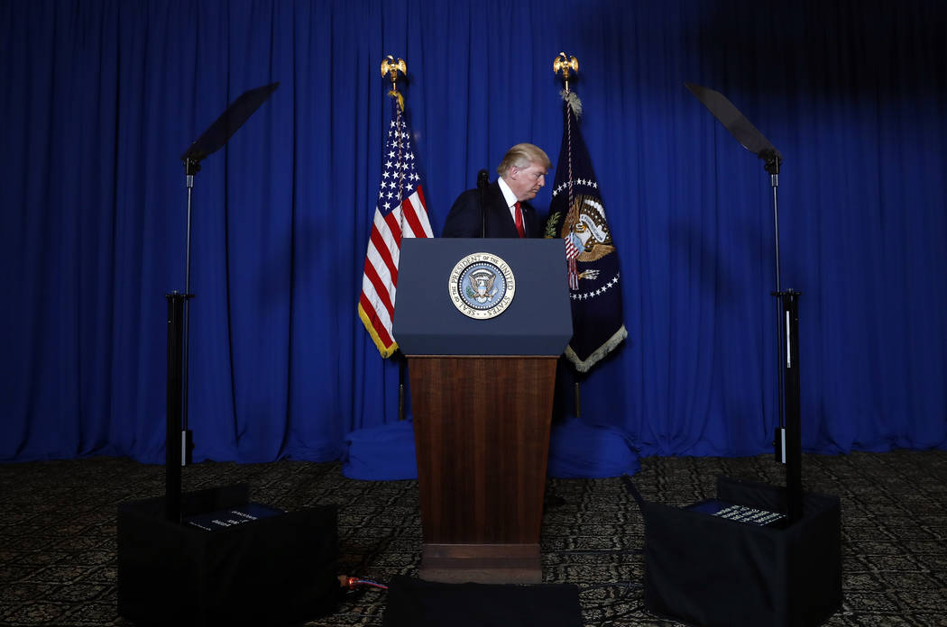 In this April 6, 2017, photo, President Donald Trump walks from the podium after speaking at Mar-a-Lago in Palm Beach, Fla., Thursday, April 6, 2017, after the U.S. fired a barrage of cruise missi ...