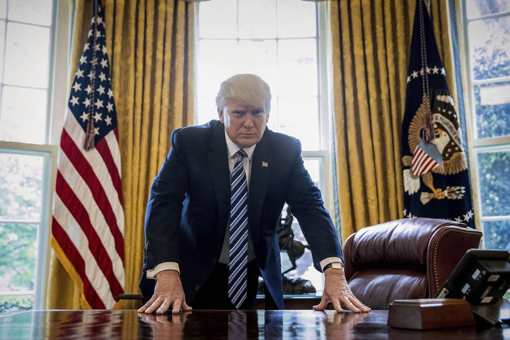 In this April 21, 2017, file photo, President Donald Trump poses for a portrait in the Oval Office in Washington after an interview with The Associated Press. (Andrew Harnik/AP)