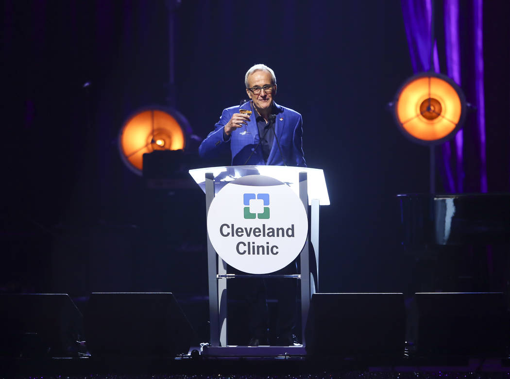 Larry Ruvo, co-founder and chairman of Keep Memory Alive, raises his glass during Keep Memory Alive's 21st annual Power of Love gala, raising money for Cleveland Clinic Lou Ruvo Center for Brain H ...
