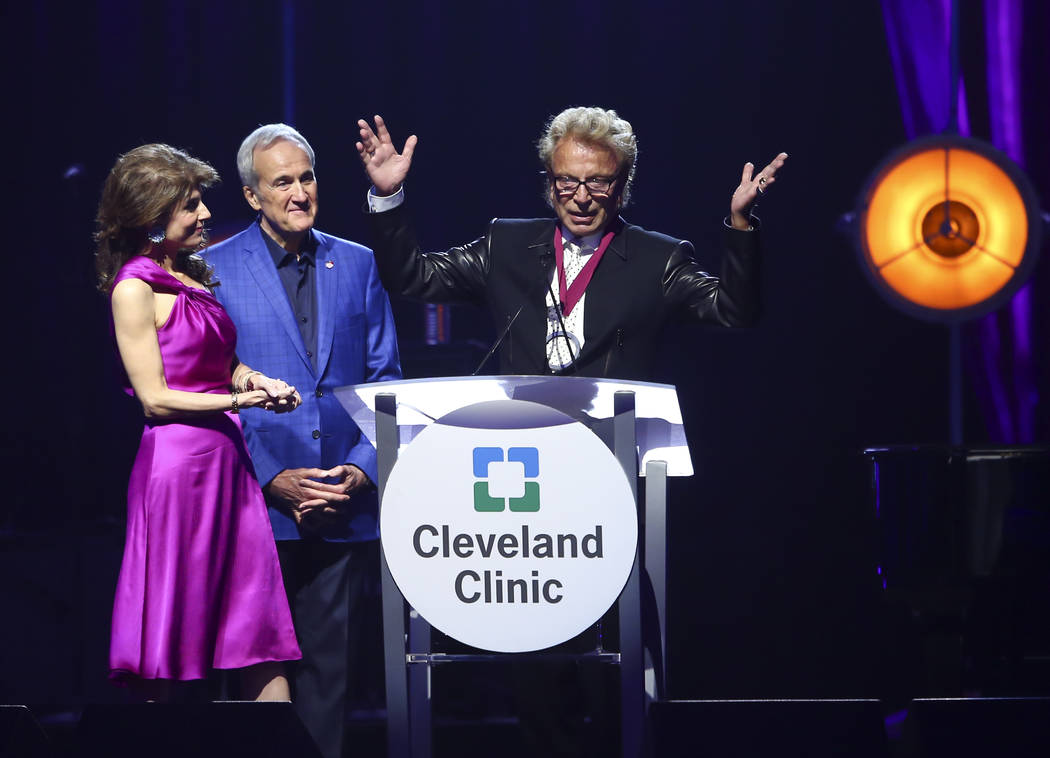 Inaugural Caregiver Award recipient Siegfried Fischbacher, right, speaks alongside Larry and Camille Ruvo during Keep Memory Alive's 21st annual Power of Love gala, raising money for Cleveland Cli ...
