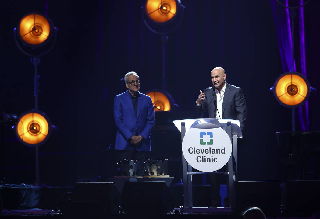 Honoree Andre Agassi, a tennis great and Las Vegas resident, right, speaks alongside Larry Ruvo, co-founder and chairman of Keep Memory Alive, during Keep Memory Alive's 21st annual Power of Love  ...