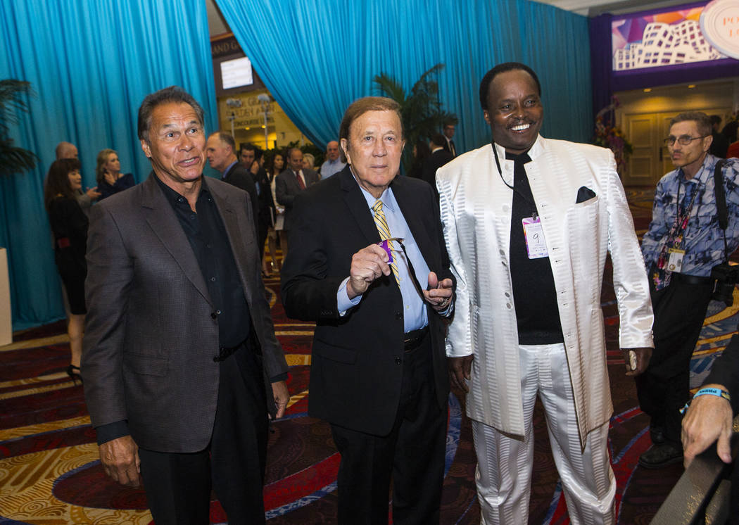 Former Oakland Raiders players Jim Plunkett, left, and Lester Hayes, right, with former head coach Tom Flores, center, before Keep Memory Alive's 21st annual Power of Love gala, raising money for  ...