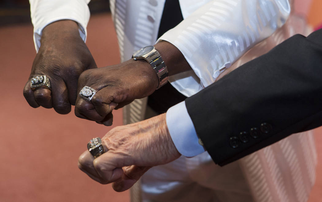 Former Oakland Raiders players Lester Hayes, left, and former Raiders head coach Tom Flores show off their rings before Keep Memory Alive's 21st annual Power of Love gala, raising money for Clevel ...