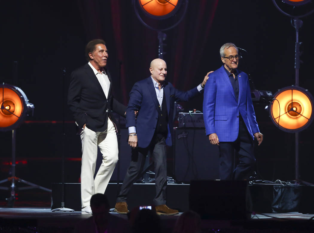 Business magnate and CEO of Wynn Resorts Steve Wynn, left, walks alongside honoree Ronald O. Perelman, chairman and CEO of MacAndrews & Forbes Inc., center, and Larry Ruvo, co-founder and chai ...