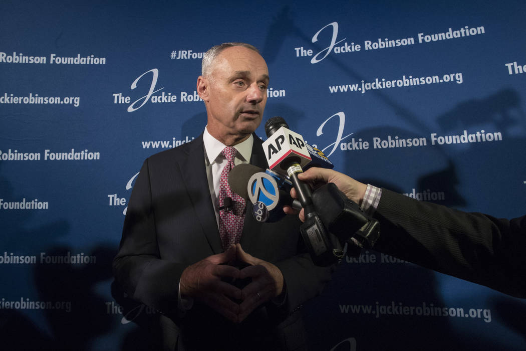 Major League Baseball Commissioner Robert D. Manfred, Jr., speaks to reporters after a ceremonial ground breaking for the Jackie Robinson Museum, Thursday, April 27, 2017, in New York. Manfred say ...