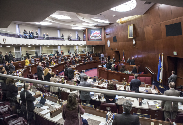 Members of the Nevada Assembly say the Pledge of Allegiance during the fourth day of the Nevada Legislative session on Thursday, Feb. 9, 2017, at the Legislative Building, in Carson City. (Benjami ...