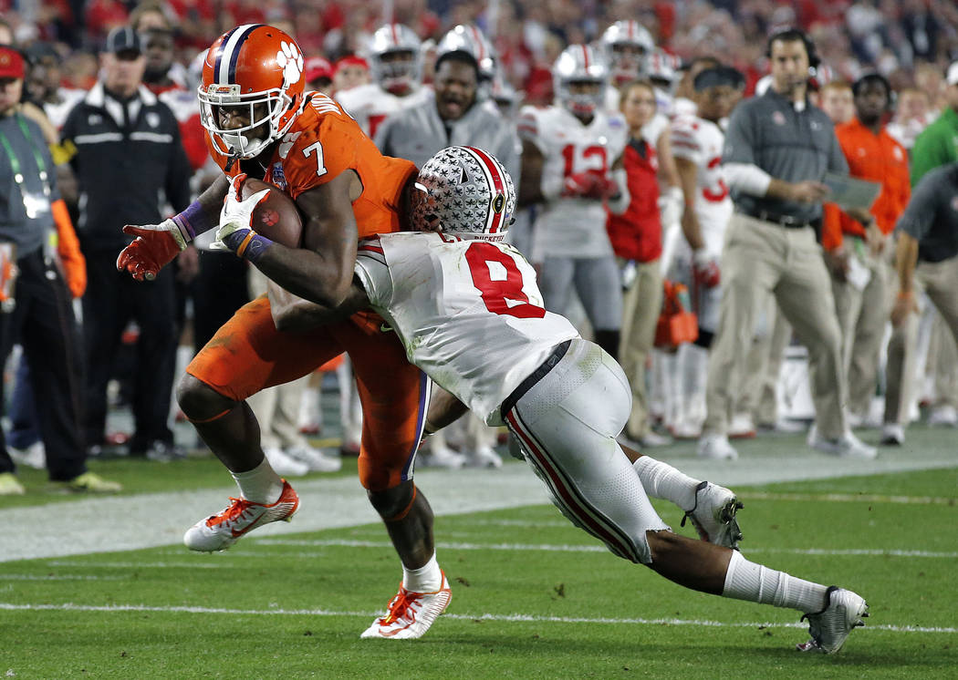 Clemson wide receiver Mike Williams (7) is stopped by Ohio State cornerback Gareon Conley (8) during the second half of the Fiesta Bowl NCAA college football game, Saturday, Dec. 31, 2016, in Glen ...