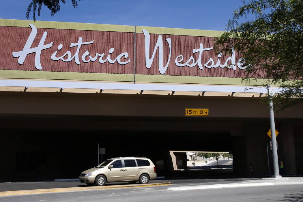 A car turns onto Bonanza Road past the Historic Westside sign above F Street in Las Vegas on Thursday, April 27, 2017. (Bizuayehu Tesfaye/Las Vegas Review-Journal) @bizutesfaye